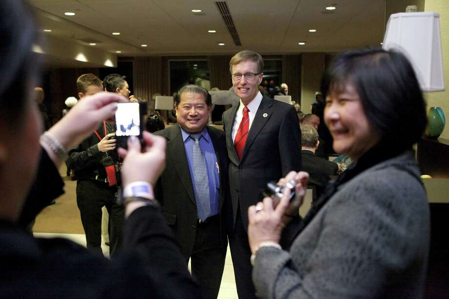 Rob McKenna takes pictures with supporters during the Washington State Republican Party's 2012 Election Night Party Nov. 6, 2012 at the Bellevue Hyatt in Bellevue, Wash. Photo: CLIFF DESPEAUX / FOR SEATTLEPI.COM