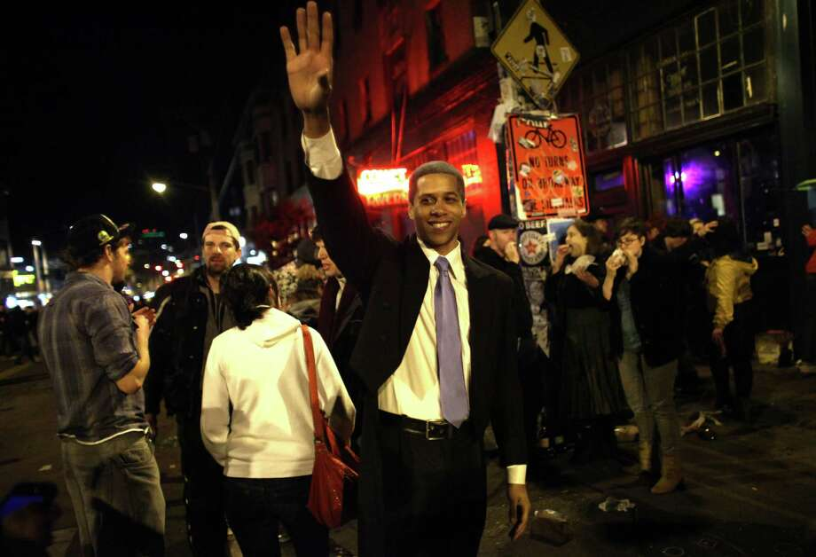 Barack Obama impersonator Jon Noble waves as a spontaneous party erupts in the intersection of East Pike Street and 10th Avenue after Barack Obama was announced as the winner, Referendum 74 appeared to be passing and a measure to legalize marijuana also seemed to be passing on Election Day, Tuesday, November 6, 2012. Photo: JOSHUA TRUJILLO / SEATTLEPI.COM