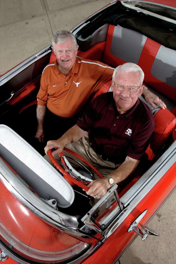 UT Coach Darrell Royal and Texas A&M Heisman Trophy winner John David Crow shown in Austin Thursday June 28, 2007 with a 1957 Chevy Belair. KEVIN GEIL/STAFF Photo: KEVIN GEIL, SAN ANTONIO EXPRESS-NEWS / SAN ANTONIO EXPRESS-NEWS