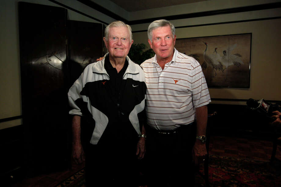 METRO -- University of Texas Head Football Coach Mack Brown, right, and former head coach Darrell Royal talks with the media before Brown addressed the lunch time crowd of the San Antonio Quarterback Club at the San Antonio Country Club, Monday, June 7, 2010. JERRY LARA/glara@express-news.net Photo: JERRY LARA, San Antonio Express-News / glara@express-news.net