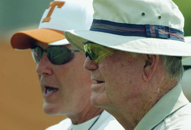 ** ADVANCE FOR THURSDAY, SEPT. 11 AND THEREAFTER ** FILE ** Texas head football coach Mack Brown, left, and former coach Darrell Royal, right, watch a team practice in this Aug. 11, 2003 photo, in Austin, Texas. Royal coached during the Southwest Conference years when the rivalry with Arkansas was at its height. Sixth-ranked Texas is set to host Arkansas Saturday. Photo: HARRY CABLUCK, AP / AP