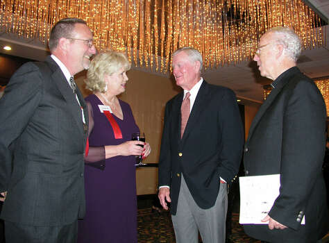 Wade Rascoe (site director and recipient), Elizabeth Collet (development director), Darrell Royal (honoree) and Father Val J. Peter (exec director) were at the Marriott Rivercenter hotel on 10/1/2003 for the Girls and Boys Town Hall of Fame. names checkekd photo by leland a. outz Photo: LELAND A. OUTZ, SPECIAL TO THE EXPRESS-NEWS / SAN ANTONIO EXPRESS-NEWS