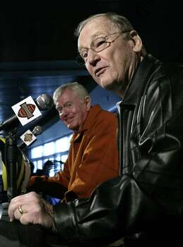 Former Michigan coach Bo Schembechler, right, speaks to reporters as former Texas coach Darrell Royal listens Thursday, Dec. 30, 2004, in Carson, Calif. Michigan will face Texas in the Rose Bowl on New Year's Day in Pasadena, Calif. Photo: NICK UT, AP / AP