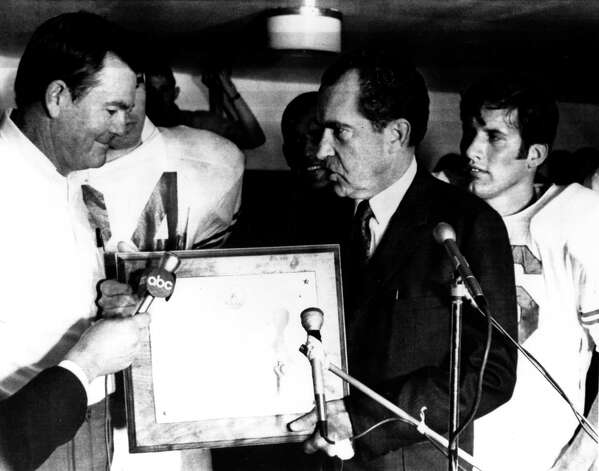 Texas coach Darrell Royal receiving the proclamation from President Richard Nixon in 1969 that the Texas Longhorns were the national champions. The Nixon photo in the locker room after the 1969 Shootout with Arkansas when the schools were Nos. 1-2.