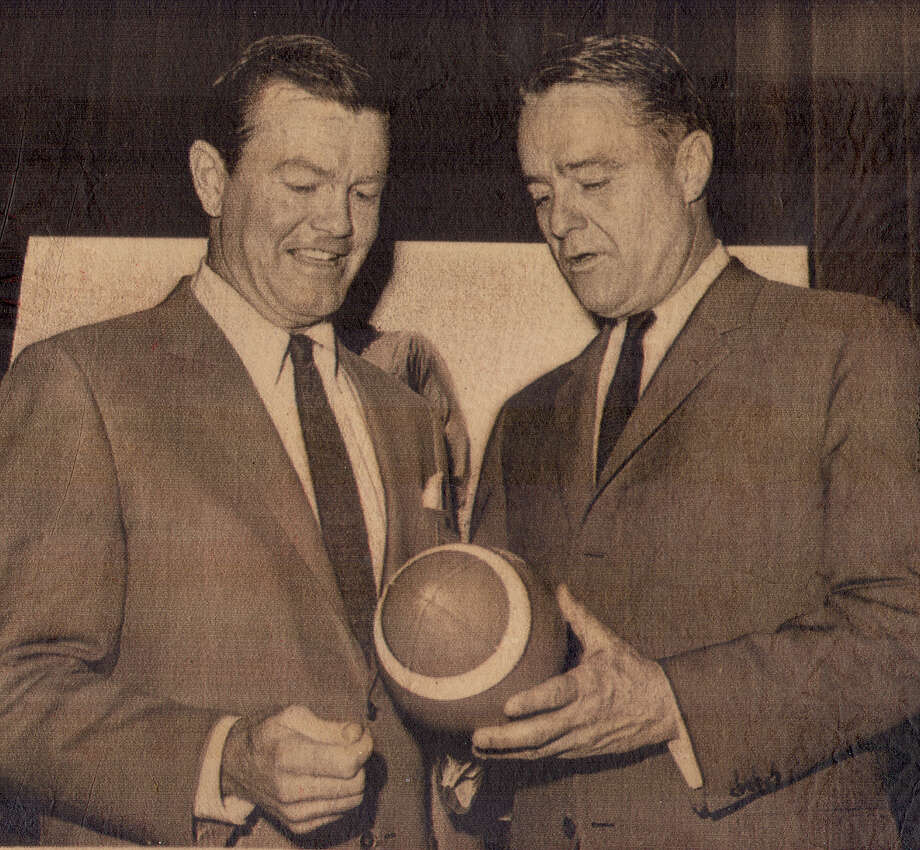1966 ... Darrell Royal talks with Sargent Shriver (right), head of the anti-poverty program, at the 60th annual convention of the NCAA at the Sheraton Park Hotel in Washington D.C.