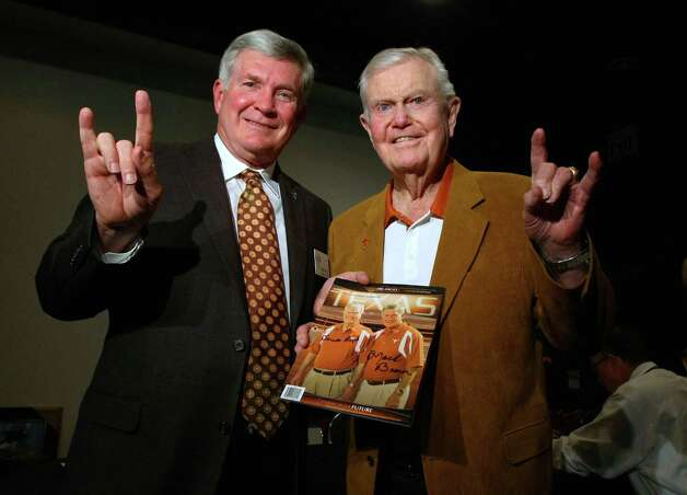 "FILE - This Feb. 29, 2012 file photo shows Texas football coach Mack Brown, left, giving the ""hook 'em horns"" sign with former coach Darrell Royal at a reception before the induction for the 2012 class of the Texas Sports Hall of Fame in Waco, Texas. The University of Texas says former football coach Darrell Royal, who won two national championships and a share of a third, has died. He was 88. UT spokesman Nick Voinis on Wednesday, Nov. 7, 2012 confirmed Royal's death in Austin. (AP Photo/Waco Tribune Herald,  Jerry Larson, File) Photo: Jerry Larson, Associated Press / Waco Tribune Herald"