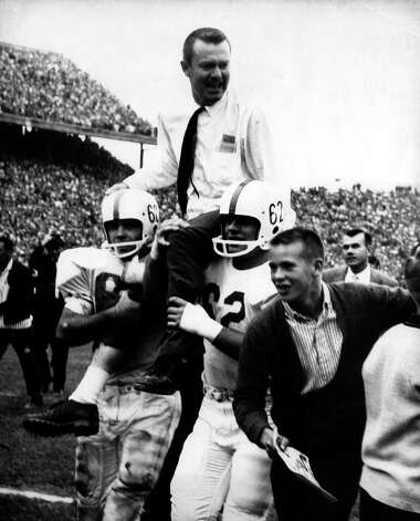 Texas players boosted Darrell Royal onto their shoulders after the Longhorns knocked off second-ranked Oklahoma in 1958. He's being carried off the field by guards H.G. Anderson (left, 68) and Dan Petty (right, 62). Photo: COURTESY PHOTO / UNIVERSITY OF TEXAS