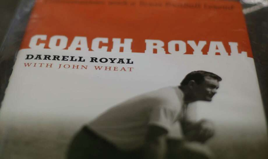 A book, part of Former Texas football coach Darrell Royal's  Longhorn memorabilia to be auctioned for Alzheimer's research, is displayed at an auction house, Tuesday, Oct. 30, 2012, in Austin, Texas. (AP Photo/Eric Gay) Photo: Eric Gay, Associated Press / AP