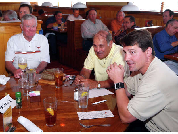 SPORTS -- FOR NATALIE ENGLAND -- Darrell Royal, Eddie Joseph, former Executive Director of the Texas High School Coaches Association and first-year Texas defensive coordinator Will Muschamp at the San Antonio Quarterback Club at the Outback Steakhouse on San Pedro Avenue.