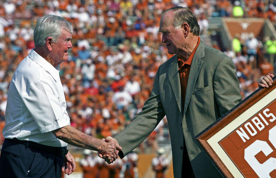 SPORTS Tommy Nobis accepts congratulations from Darrell Royal after having his number 60 retired in Austin Saturday. Texas versus Arkansas at Memorial Stadium in Austin Saturday, September 27, 2008. Tom Reel/Staff Photo: TOM REEL, SAN ANTONIO EXPRESS-NEWS / treel@express-news.net