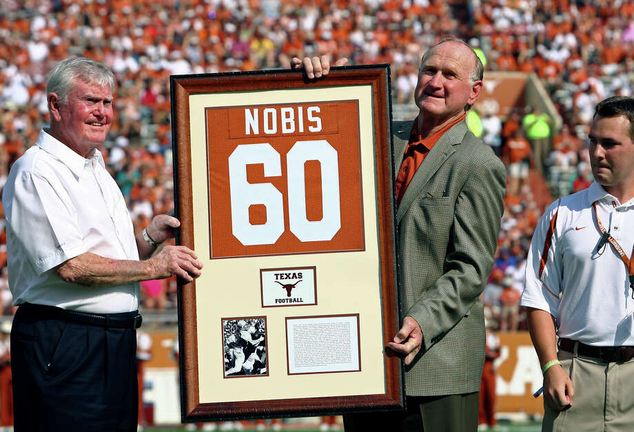 Darrell Royal was on hand to help retire Tommy Nobis' number 60 Saturday, September 27, 2008 in Austin. The Texas football legend died Wednesday, Dec. 12, 2017 at the age of 74. Photo: TOM REEL, SAN ANTONIO EXPRESS-NEWS / treel@express-news.net