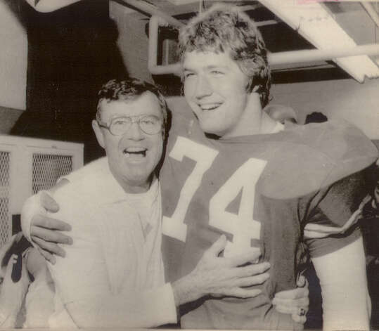 University of Texas coach Darrell Royal and tackle Doug English smile in the dressing room following Friday's game with Texas &M at Austin. Texas won 32-3 in 1974.