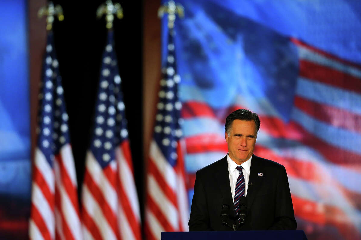 BOSTON, MA - NOVEMBER 07: Republican presidential candidate, Mitt Romney, speaks at the podium as he concedes the presidency during Mitt Romney's campaign election night event at the Boston Convention & Exhibition Center on November 7, 2012 in Boston, Massachusetts. After voters went to the polls in the heavily contested presidential race, networks projected incumbent U.S. President Barack Obama has won re-election against Republican candidate, former Massachusetts Gov. Mitt Romney.