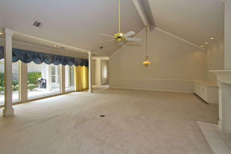 The living room has a quite spacious feel with ample square footage, high ceilings and nearly a wall of windows.