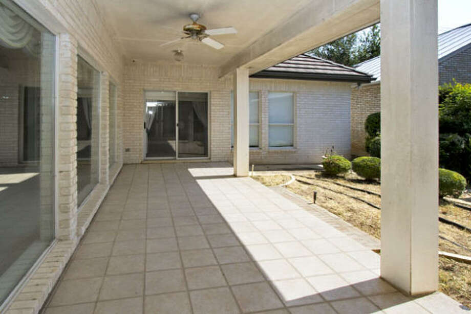 Just beyond the stretch of living room windows is the covered patio which looks out on the courtyard.
