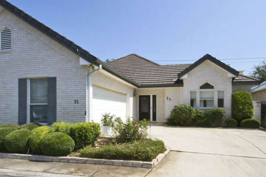 The spacious driveway and garage combine to provide enough parking space for the family and more.