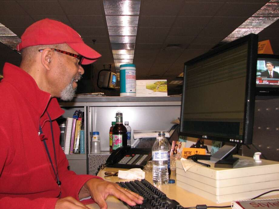 News editor Ken Thurman, a veteran of many an election night, fine-tunes a story.