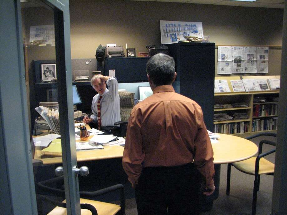 News Editor Gary Hahn checks in with Editor Rex Smith at midnight.