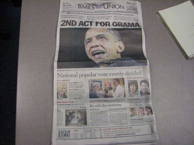 The Times Union A1, with a late night photo of Obama moved over from Getty Images.