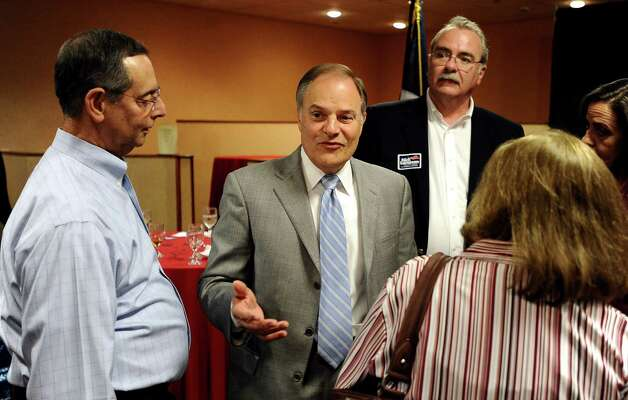 Democratic congressional candidate Nick Lampson mingles with supporters at the Holiday Inn on Walden Road in Beaumont on Tuesday, November 6,  2012. Photo taken: Randy Edwards/The Enterprise Photo: Randy Edwards