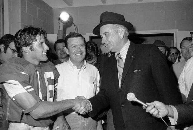 FILE - This Jan. 1, 1970 file photo shows former President Lyndon B. Johnson congratulating University of Texas quarterback James Street and coach Darrell Royal, center, in the dressing room after the Longhorns defeated Notre Dame in the Cotton Bowl in Dallas. The University of Texas says  Royal, who won two national championships and a share of a third, has died. He was 88. UT spokesman Nick Voinis on Wednesday, Nov. 7, 2012 confirmed Royal's death in Austin. Royal was close friends with former President Johnson, who attended Texas football games once his presidency ended.  (AP Photo/File) Photo: Anonymous, Associated Press / AP