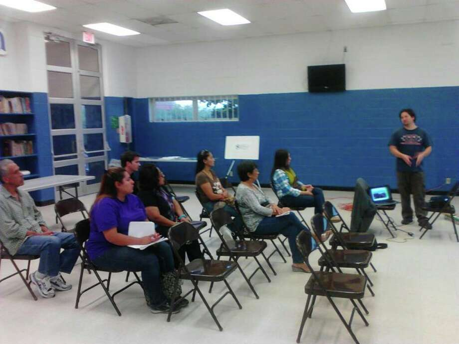Andy Castillo, standing at the right, leads a meeting last week for the South San Main Street Project. Photo: Courtesy Photo