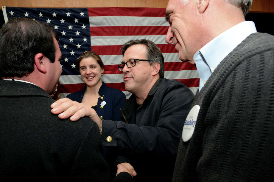 Frank Farricker, DTC Chairman, speaks words of encouragement to Daniel Dauplaise, Democratic candidate for the state senate 26th District, far left, as results are reported at the Democrat headquarters on Thursday, Nov. 6, 2012. With Farricker and Dauplaise are Katie Blankley and her father John Blankley, candidate for state represenative of the 149th District. Democratic candidates for the General Assembly gathered at the Greenwich Senior Center, 299 Greenwich Ave., to view election night results  on Tuesday, Nov. 6, 2012. Photo: Amy Mortensen / Connecticut Post Freelance
