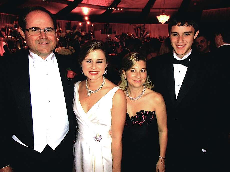 Andy Mitchell, from left, enjoys the Opening German Club ball with debutante daughter Morgan, wife Leah and son Drew. Photo: San Antonio Express-News