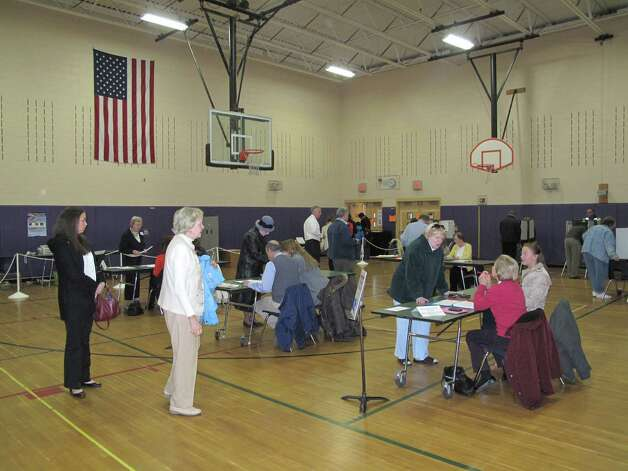 Voters stand in line at Saxe Middle School to cast their ballots on Tuesday morning, Nov. 6. Photo: Tyler Woods