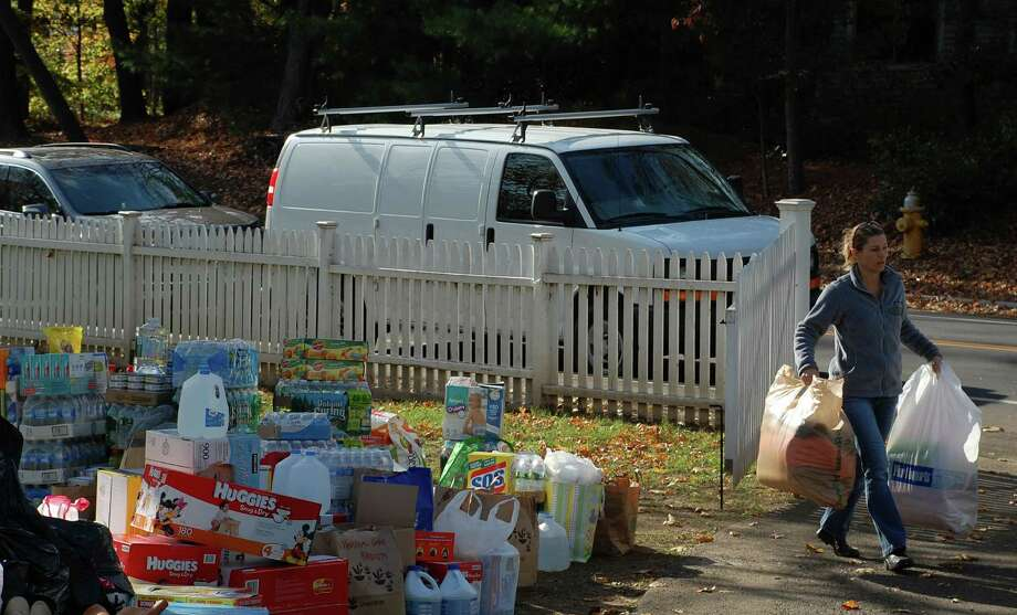 "Dale Najarian of Westport helps organize the local donations collected for New York victims of Hurricane Sandy. ""I'm from the New Jersey shore, so it seems very surreal,"" she said. ""It's so much closer to home."" Photo: Jarret Liotta / Westport News contributed"