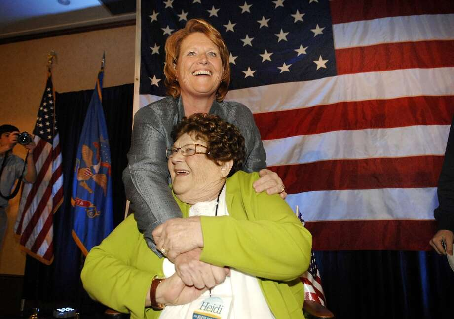 Democratic candidate for North Dakota's U.S. Senate seat, Heidi Heitkamp, hugs her Mother Doreen Heitkamp early Wednesday morning Nov. 7, 2012 in Bismarck, N.D.. At the time, Heitkamp was leading Republican challenger Rick Berg by several thousand votes. (AP Photo/Will Kincaid) Photo: WILL KINCAID, AP / FR16249 AP