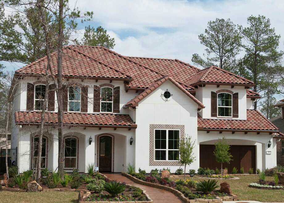 The Stanford by J. Patrick Homes is in Spincaster North in The Woodlands? Village of Creekside Park. This two-story home features 4,443 square feet, four bedrooms, 3.5 baths, rear covered patio and a three-car tandem garage with a portico. The home is $585,990. Photo: Ted Washington / Copyright©Ted Washington