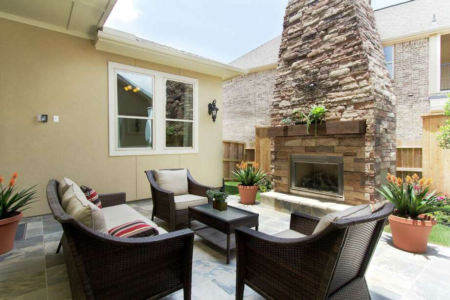 Grand opening this weekend in Cinco Ranch, four new patio-home models priced from the $220,000s to $400,000s have covered and open-air outdoor living spaces with fireplaces, outdoor kitchens, fountains and artwork. By Village Builders and  Weekley, these models are in a new neighborhood with a private clubhouse. Photo: Connie Anderson, Owner | Photographer
