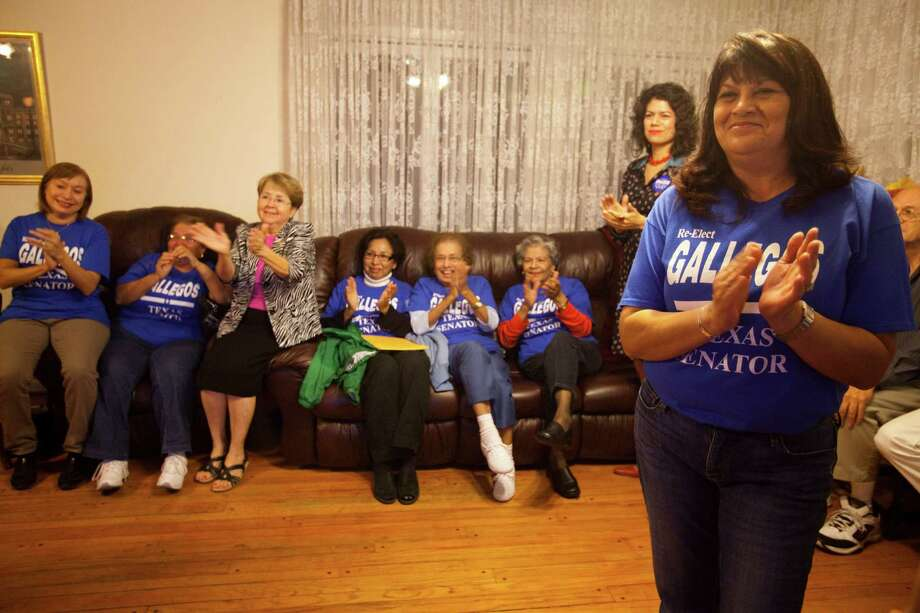 Theresa Gallegos, right, wife of deceased Sen. Mario Gallegos, claps as she watches positive election results for her husband at a watch party on Nov. 6 in Houston. Gallegos, who passed away in October, is still on the November ballot. He had to win in order to keep his seat in Democratic hands and allow the residents of Senate District 6 to elect his replacement. Photo: Eric Kayne / 2012 Eric Kayne