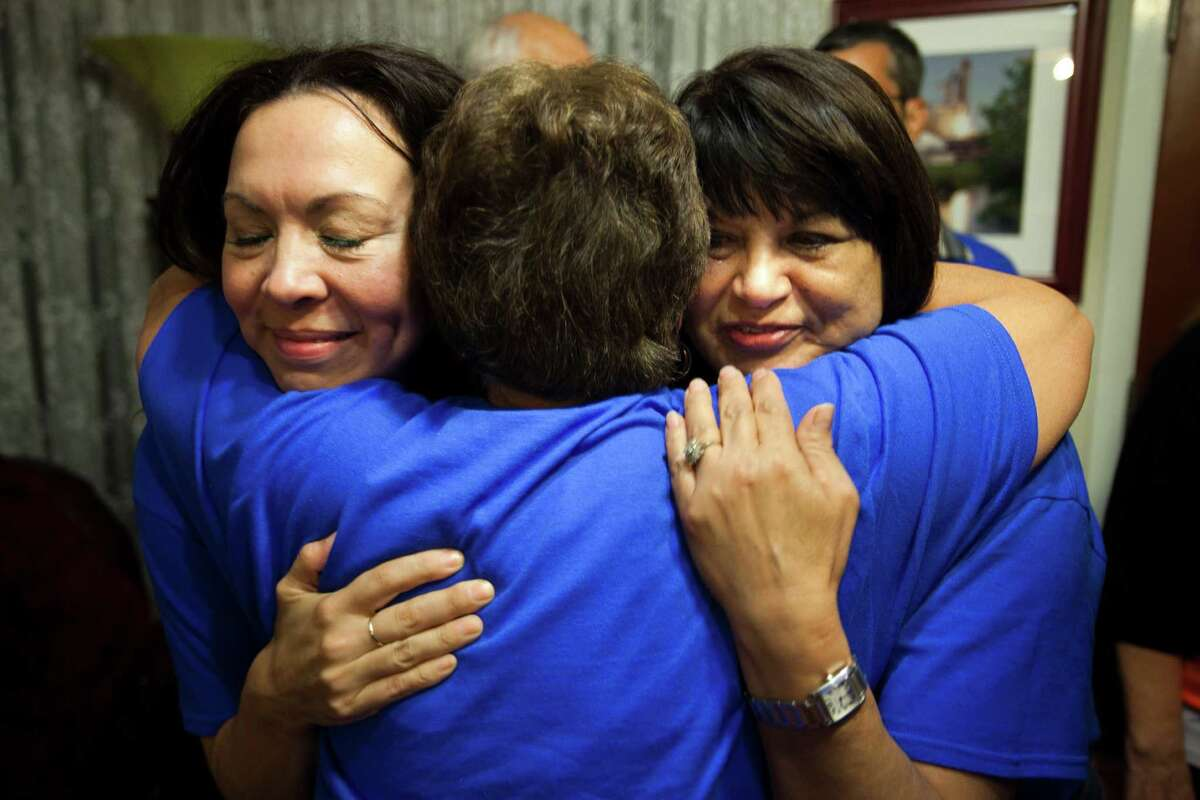 Ali Templer, left, daughter of late Sen. Mario Gallegos, Connie Sanchez and Theresa Gallegos, wife of Senator Gallegos, embrace after positive election results come in.