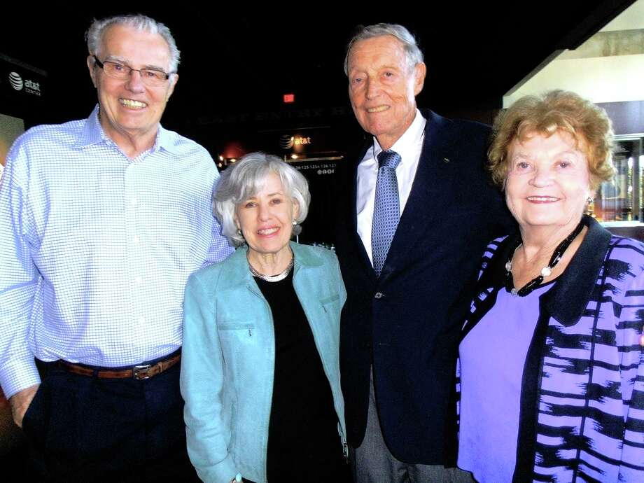 Former Spurs coach Doug Moe, from left, visits with Carol Muir and Tom and Pat Frost at a reception. Photo: Nancy Cook-Monroe