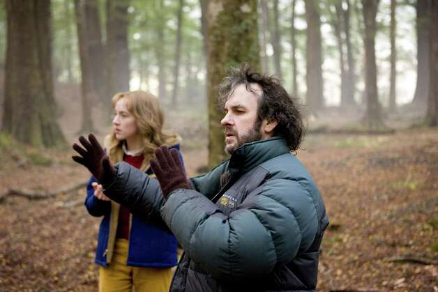 "Saoirse Ronan, left, who stars as Susie Salmon, works behind-the-scenes with director and producer Peter Jackson on ""The Lovely Bones"" from DreamWorks Pictures. (DreamWorks/MCT) Photo: Handout, HO / MCT"