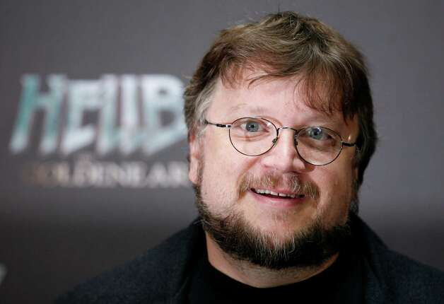 "FILE - In this Aug. 19, 2008 file photo, Mexican director Guillermo del Toro poses for the media during a photo call to promote the movie  ""Hellboy 2-The Golden Army"" in Berlin. Del Toro said Monday, May 31, 2010, that production delays have forced him to quit the planned film version of J.R.R. Tolkien's ""The Hobbit,"" a two-part prequel to New Zealand filmmaker Peter Jackson's blockbuster trilogy ""Lord of the Rings."" (AP Photo/Miguel Villagran, File) Photo: Miguel Villagran, STR / AP"
