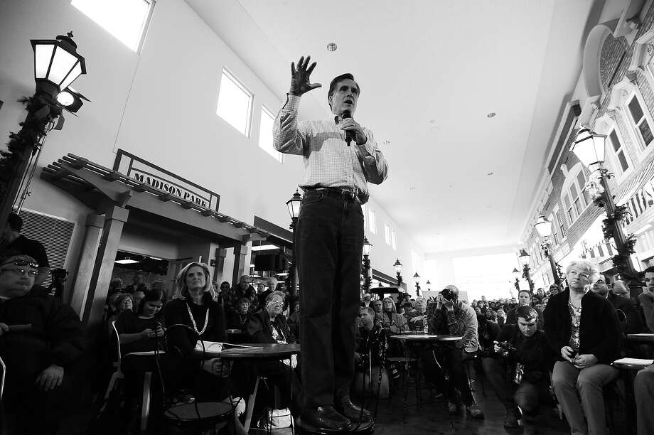 BLACK AND WHITE VERSION - Republican presidential hopeful Mitt Romney (C) speaks during a meeting with voters at the Music Man Square in Mason City, Iowa on December 29, 2011. Mitt Romney has seized the lead in Iowa days before the unpredictable heartland state's caucus kicks off voting to decide the Republican presidential nominee, a new poll showed on December 28. Romney -- often described as the candidate to beat because of his campaign warchest and high-profile endorsements -- has struggled to boost his national support past roughly 25 percent of Republican voters. AFP Photo/Jewel Samad        (Photo credit should read JEWEL SAMAD/AFP/GettyImages) Photo: JEWEL SAMAD, AFP/Getty Images / 2012 AFP