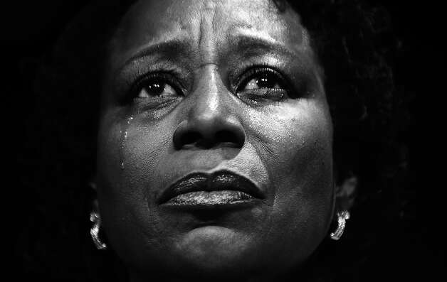 BLACK AND WHITE VERSION - A supporter cries as she listens to US President Barack Obama address a campaign event at the University of Illinois at Chicago in Chicago, Illinois, on January 11, 2012. Obama sought to strike an implicit contrast with his most likely general election foe Mitt Romney, imploring big businesses to bring home US jobs outsourced overseas. White House officials insist that Obama has not yet started to focus on his bid for a second term in November, but is instead concentrating every day on his job, which he sees as reviving the economy and cutting unemployment. AFP Photo/Jewel Samad        (Photo credit should read JEWEL SAMAD/AFP/GettyImages) Photo: JEWEL SAMAD, AFP/Getty Images / 2012 AFP