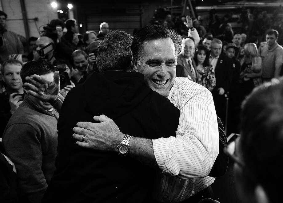 BLACK AND WHITE VERSION - Republican presidential hopeful Mitt Romney greets a supporter after addressing a speech at Gilchrist Metal Fabricating in Hudson, New Hampshire, on January 9, 2012.  New Hampshire will hold its Republican primary on January 10, 2012.  AFP PHOTO/Emmanuel Dunand        (Photo credit should read EMMANUEL DUNAND/AFP/GettyImages) Photo: EMMANUEL DUNAND, AFP/Getty Images / 2012 AFP