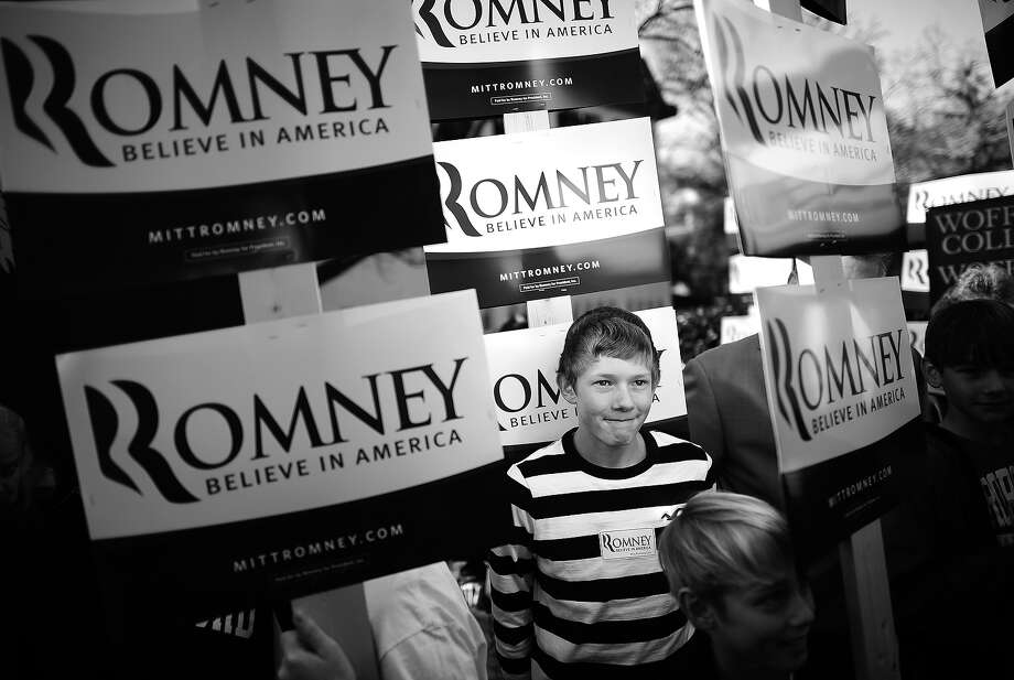 BLACK AND WHITE VERSION - Republican presidential hopeful Mitt Romney supporters await his arrival during a campaign rally at Wofford College in Spartanburg, South Carolina, on January 18, 2012. South Carolina will hold its Republican primary on January 21, 2012.  AFP PHOTO/Emmanuel Dunand        (Photo credit should read EMMANUEL DUNAND/AFP/GettyImages) Photo: EMMANUEL DUNAND, AFP/Getty Images / 2012 AFP