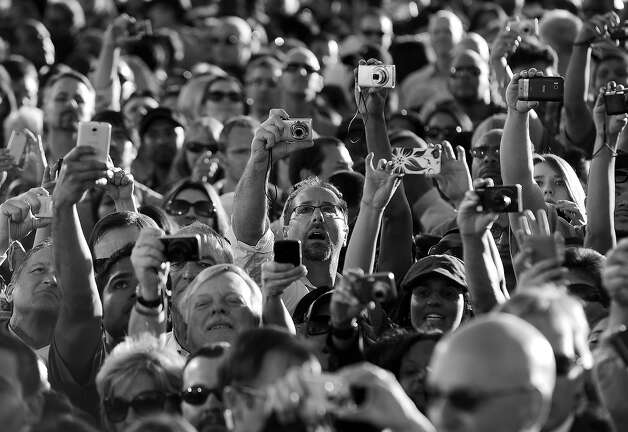 BLACK AND WHITE VERSION - A crowd of people photograph US President Barack Obama speaking at the Intel Ocotillo Campus in Chandler, Arizona, on January 25, 2012. Obama kicked off a three-day five-state tour, one day after his State of Union speech. Obama wants large tax hikes on millionaires to finance a fair economy for all, a populist vision aimed at convincing crisis-weary voters he merits a second White House term. In his annual State of the Union address -- which this year served as a grand kick-off of his 2012 reelection campaign, Obama played on rising anger over inequality in the wake of the 2008 economic collapse. AFP Photo/Jewel Samad        (Photo credit should read JEWEL SAMAD/AFP/GettyImages) Photo: JEWEL SAMAD, AFP/Getty Images / 2012 AFP