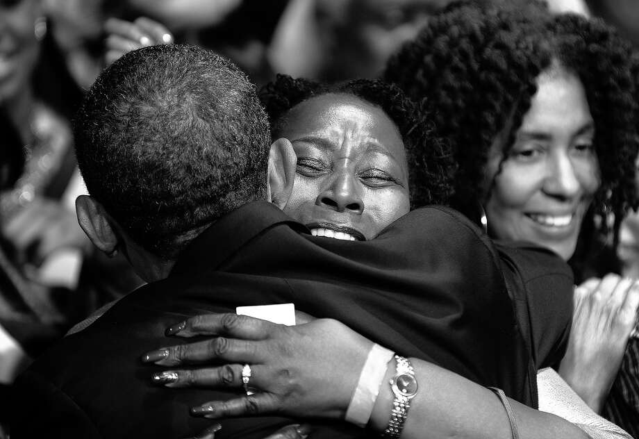 BLACK AND WHITE VERSION - US President Barack Obama greets supporters after addressing a campaign event at the University of Illinois at Chicago in Chicago, Illinois, on January 11, 2012. Obama sought to strike an implicit contrast with his most likely general election foe Mitt Romney, imploring big businesses to bring home US jobs outsourced overseas. White House officials insist that Obama has not yet started to focus on his bid for a second term in November, but is instead concentrating every day on his job, which he sees as reviving the economy and cutting unemployment. AFP Photo/Jewel Samad        (Photo credit should read JEWEL SAMAD/AFP/GettyImages) Photo: JEWEL SAMAD, AFP/Getty Images / 2012 AFP