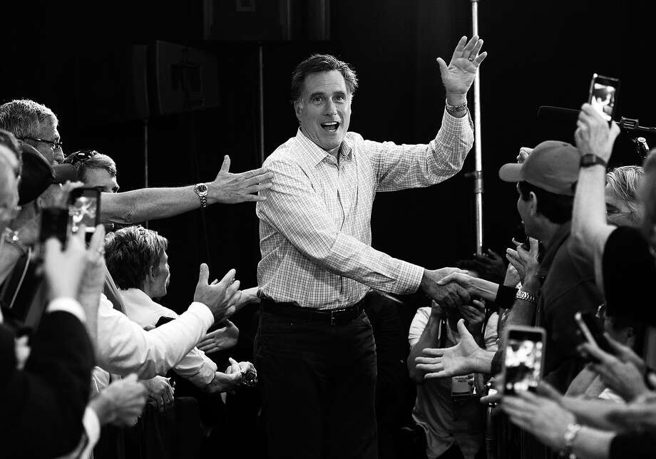 BLACK AND WHITE VERSION - Republican presidential hopeful Mitt Romney greets supporters as he holds a campaign rally at Emma Lou Olson Civic Center in Pompano Beach, Florida, January 29, 2012. Florida will hold its Republican primary on January 31, 2012. AFP PHOTO/Emmanuel Dunand        (Photo credit should read EMMANUEL DUNAND/AFP/GettyImages) Photo: EMMANUEL DUNAND, AFP/Getty Images / 2012 AFP