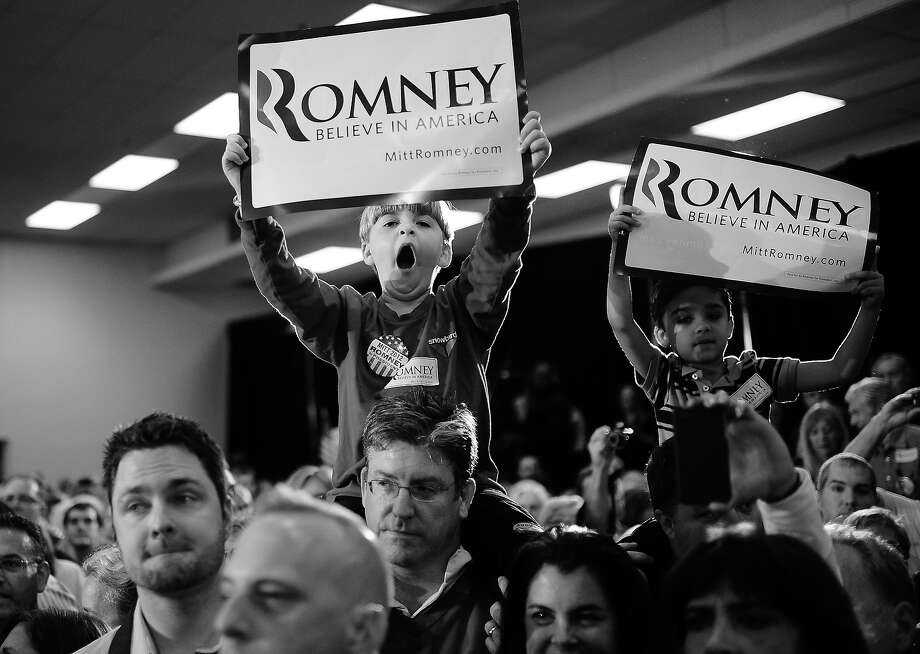 BLACK AND WHITE VERSION - Republican presidential hopeful Mitt Romney supporters attend a campaign rally at Emma Lou Olson Civic Center in Pompano Beach, Florida, January 29, 2012. Florida will hold its Republican primary on January 31, 2012. AFP PHOTO/Emmanuel Dunand        (Photo credit should read EMMANUEL DUNAND/AFP/GettyImages) Photo: EMMANUEL DUNAND, AFP/Getty Images / 2012 AFP