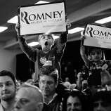 BLACK AND WHITE VERSION - Republican presidential hopeful Mitt Romney supporters attend a campaign rally at Emma Lou Olson Civic Center in Pompano Beach, Florida, January 29, 2012. Florida will hold its Republican primary on January 31, 2012. AFP PHOTO/Emmanuel Dunand        (Photo credit should read EMMANUEL DUNAND/AFP/GettyImages)