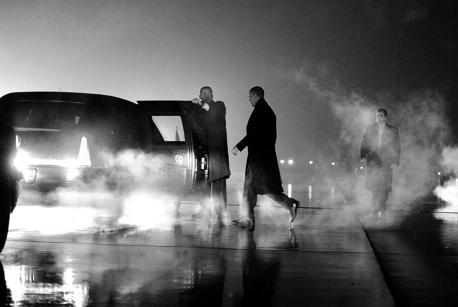 BLACK AND WHITE VERSION - US President Barack Obama walks to his car upon arriving in Romules, Michigan, on January 26, 2012. AFP Photo/Jewel Samad        (Photo credit should read JEWEL SAMAD/AFP/GettyImages) Photo: JEWEL SAMAD, AFP/Getty Images / 2012 AFP