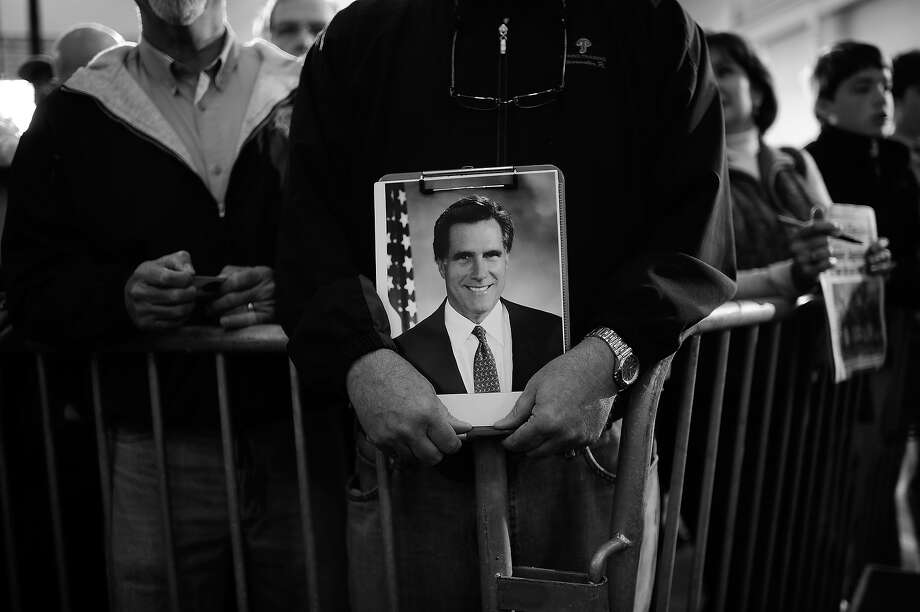 BLACK AND WHITE VERSION - Republican presidential hopeful Mitt Romney supporters attend a campaign rally at Ring Power Lift Trucks in Jacksonville, Florida, on January 30, 2012. Florida will hold its Republican primary on January 31, 2012. AFP PHOTO/Emmanuel Dunand        (Photo credit should read EMMANUEL DUNAND/AFP/GettyImages) Photo: EMMANUEL DUNAND, AFP/Getty Images / 2012 AFP
