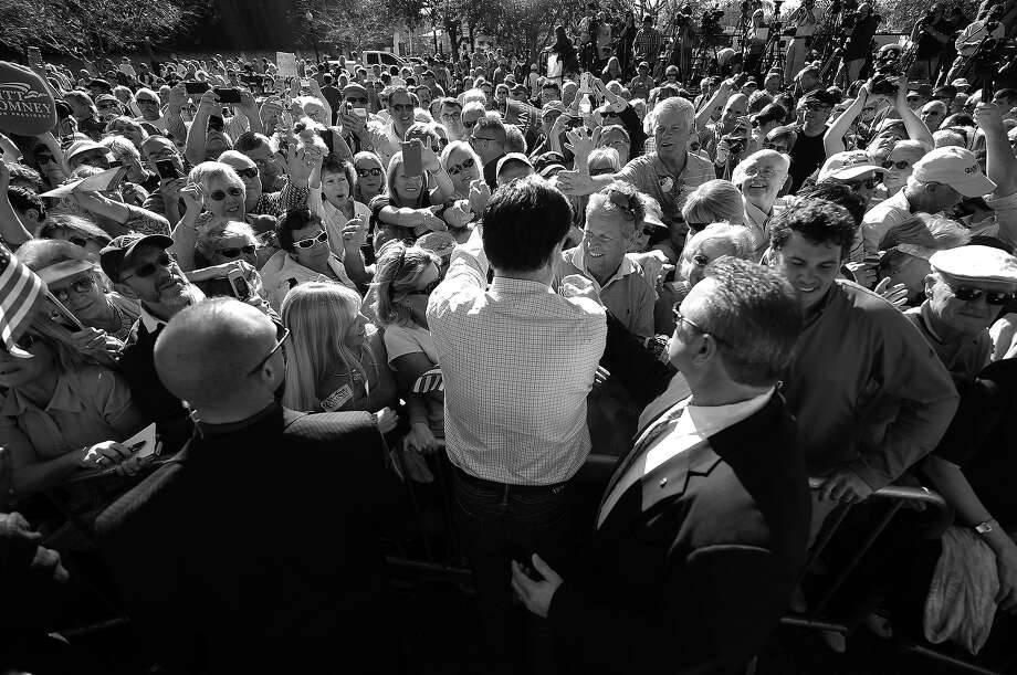BLACK AND WHITE VERSION - Republican presidential hopeful Mitt Romney holds a campaign rally at Pioneer Park in Dunedin, Florida, January 30, 2012. Florida will hold its Republican primary on January 31, 2012. AFP PHOTO/Emmanuel Dunand        (Photo credit should read EMMANUEL DUNAND/AFP/GettyImages) Photo: EMMANUEL DUNAND, AFP/Getty Images / 2012 AFP